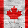 Canada flag painted on old wood plank background — Stock Photo #30917267