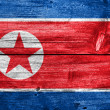 North Korea flag painted on old wood plank background — Stock Photo