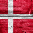 Denmark Flag painted on old wood plank background — Stock Photo