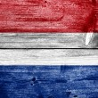 Netherlands Flag painted on old wood plank background — Stock Photo