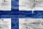 Finland Flag painted on old wood plank background — Stock Photo