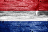 Netherlands Flag painted on old wood plank background — Stock Photo