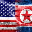 USA and North Korea Flag painted on grunge wall — Stock Photo