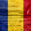 Romania Flag painted on old wood plank background — Stock Photo