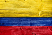 Colombia Flag painted on old wood plank background — Stock Photo