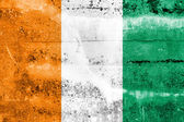 Ivory Coast Flag painted on grunge wall — Foto Stock