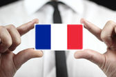 Businessman holding a business card with a France Flag — Foto de Stock
