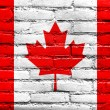 Canada Flag painted on old brick wall — Stock Photo