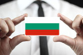 Businessman holding a business card with Bulgaria Flag — Stock Photo