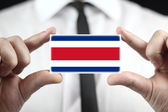 Businessman holding a business card with a Costa Rica Flag — Stock Photo
