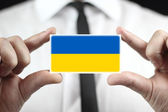 Businessman holding a business card with a Ukraine Flag — Photo