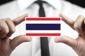 Businessman holding a business card with a Thailand Flag — Stock Photo