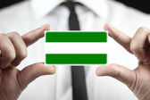 Businessman holding a business card with Rotterdam City Flag — Stock Photo