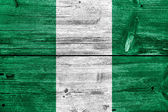 Nigeria Flag painted on old wood plank texture — Stock Photo