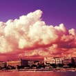 Clouds in Cannes. Famous bay of cannes in France with the beach and buildings in the background — Stock Photo