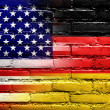 USA and Germany Flag painted on brick wall — Stock Photo #34631447