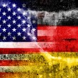USA and Germany Flag painted on grunge wall — Stock Photo