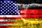 USA and Germany Flag painted on grunge wall — Foto de Stock