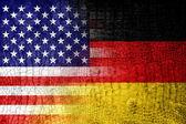 USA and Germany Flag painted on luxury crocodile texture — Stock Photo