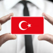 Businessman holding a business card with Turkey Flag — Stock Photo #35585003