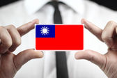 Businessman holding a business card with Taiwan Flag — Stock fotografie
