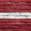 Stock Photo: LatviFlag painted on brick wall