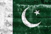 Pakistan Flag painted on grunge wall — Stock Photo