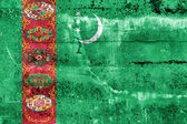 Turkmenistan Flag painted on grunge wall — Stok fotoğraf
