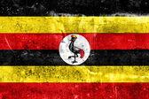 Uganda Flag painted on grunge wall — Stock Photo