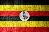 Uganda Flag painted on luxury crocodile texture — Stock Photo