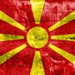 Stock Photo: MacedoniFlag painted on grunge wall
