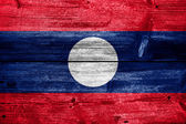 Laos Flag painted on old wood plank texture — Foto de Stock
