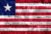 Liberia Flag painted on grunge wall — Stock fotografie