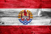 French Polynesia Flag painted on old wood plank texture — Stock fotografie