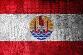 French Polynesia Flag painted on luxury crocodile texture — Stock Photo