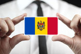 Businessman holding a business card with Moldova Flag — Stok fotoğraf