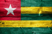 Togo Flag painted on old wood plank texture — Stock fotografie