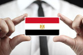 Businessman holding a business card with Egypt Flag — Stock fotografie