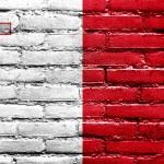 Malta Flag painted on brick wall — Stock Photo #39355975