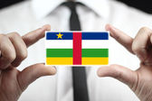 Businessman holding a business card with Central African Republic Flag — Stock Photo