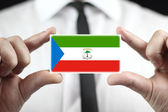 Businessman holding a business card with Equatorial Guinea Flag — Stock Photo