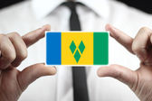 Businessman holding a business card with Saint Vincent and Grenadines Flag — Stock Photo