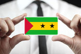 Businessman holding a business card with Sao Tome and Principe Flag — Stock Photo