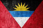 Antigua and Barbuda Flag painted on luxury crocodile texture — Stock Photo