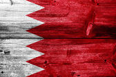 Bahrain Flag painted on old wood plank texture — Stock Photo