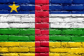 Central African Republic Flag painted on brick wall — Stock Photo