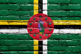 Dominica Flag painted on brick wall — Stock Photo