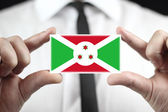 Businessman holding a business card with Burundi Flag — Foto Stock