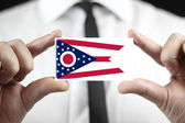 Businessman holding a business card with Ohio State Flag — Foto Stock