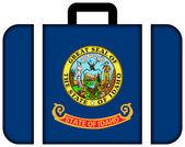 Resväska med idaho state flagga — Stockfoto